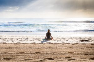 a girl meditating- how to set goals for life