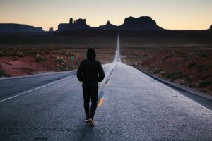 a man walking alone on the road- how to set goals for life