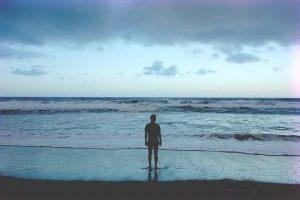 man standing in ocean